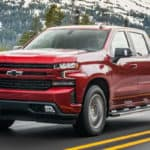 Red 2020 Chevrolet Silverado 3.0L Duramax with snowy mountains in the background