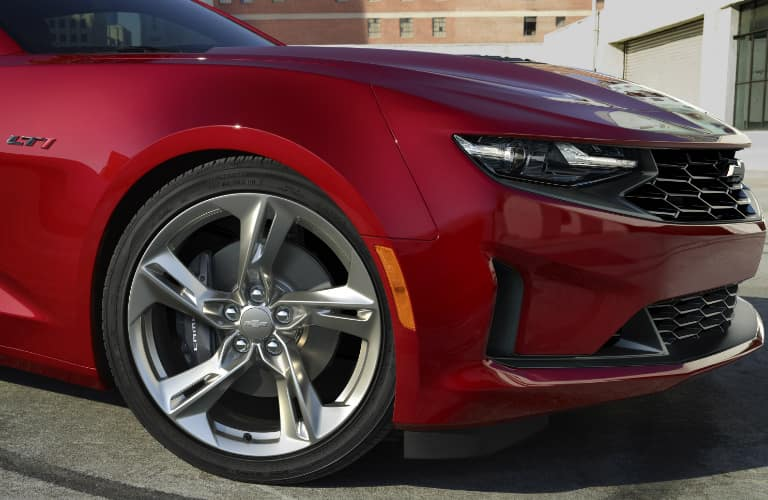 Wheel, headlight, and grille on red 2020 Chevrolet Camaro