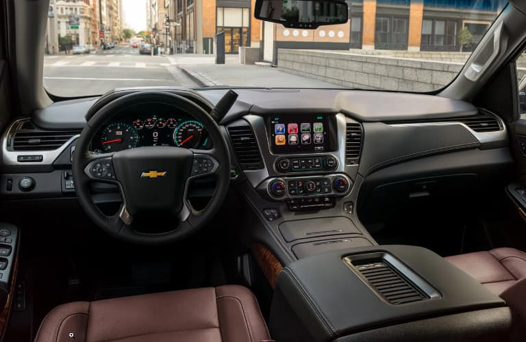 Dashboard and maroon front seats in 2020 Chevrolet Suburban