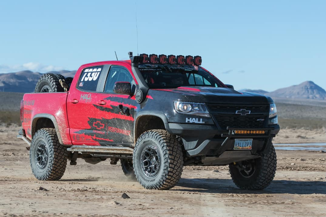Front view of red and black Chevrolet Colorado ZR2 competing in a Best in the Desert Race