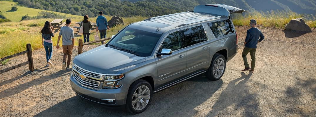 Grey 2020 Chevrolet Suburban parked on top of a hill