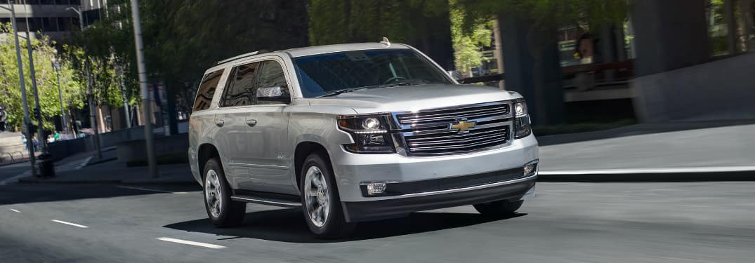 Silver 2020 Chevrolet Tahoe driving on a city street