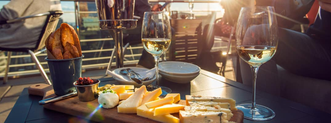 Wine and cheese at a rooftop bar