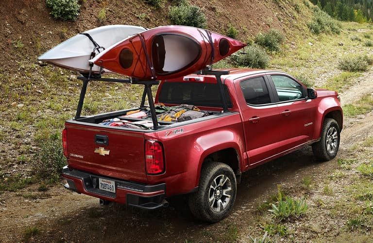 Red 2020 Chevrolet Colorado carrying two kayaks