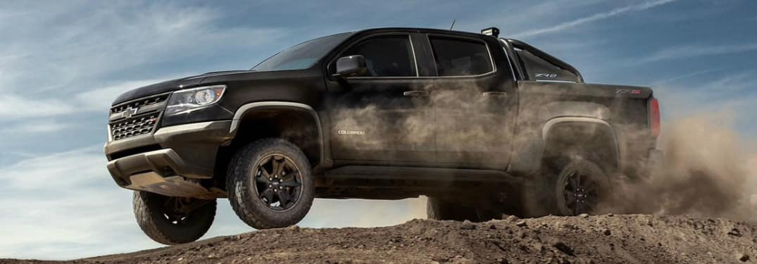 Black 2020 Chevrolet Colorado driving on a gravel road