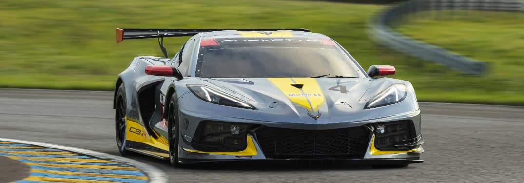 Front view of silver and yellow Chevrolet C8.R race car