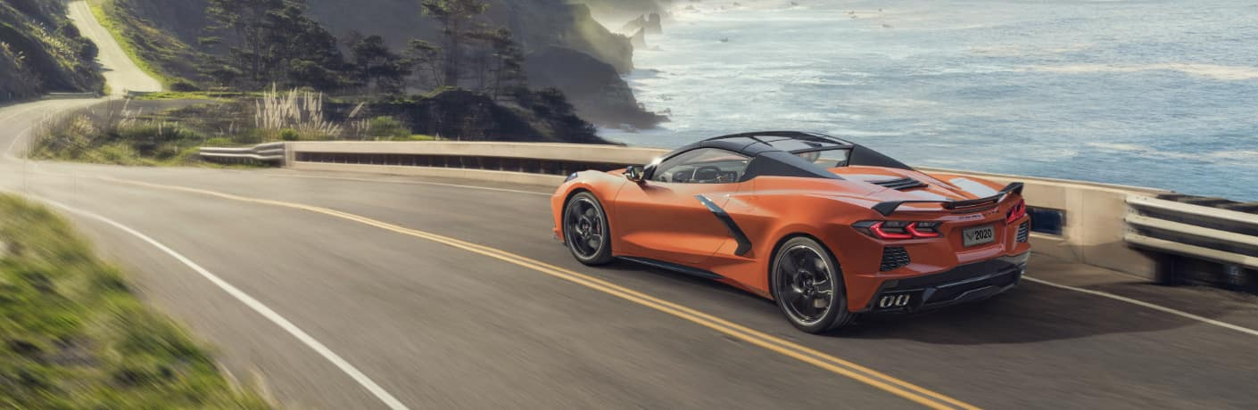 Orange 2020 Chevrolet Corvette Stingray Convertible driving on a coastal road