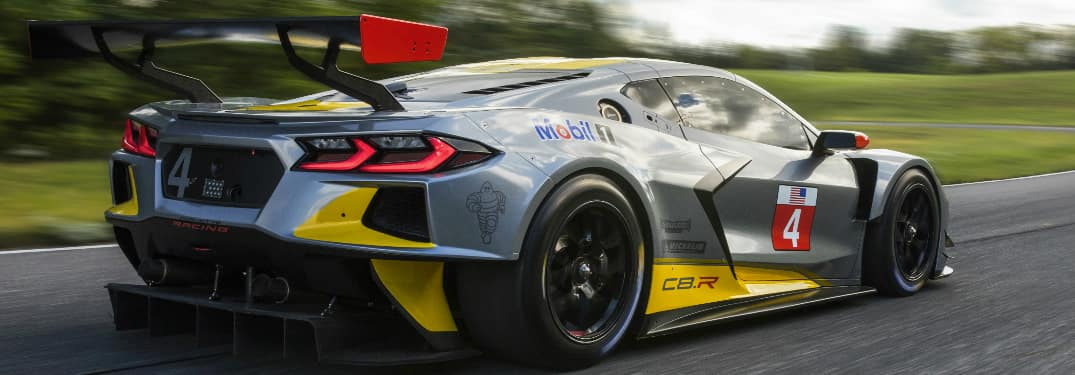Rear view of silver and yellow Chevrolet C8.R race car