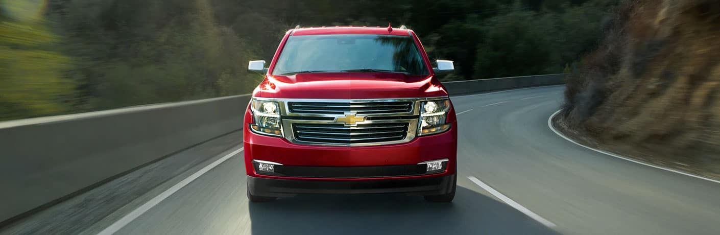red chevrolet tahoe front view
