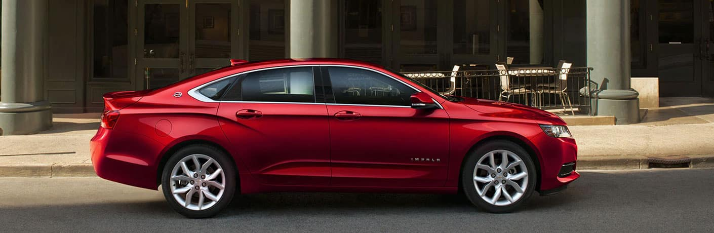 red chevrolet impala side view
