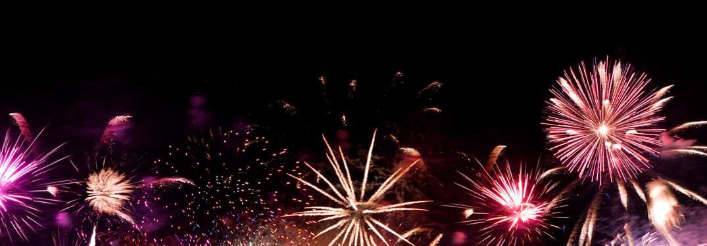 pink fireworks on a black sky