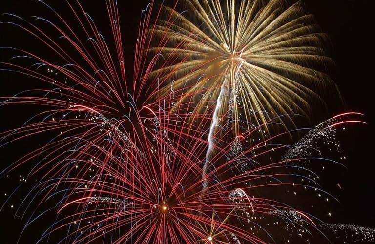 three fireworks on a black sky