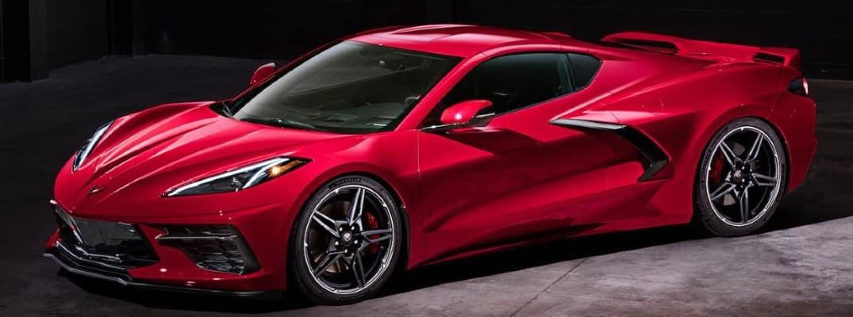 red chevrolet corvette side view