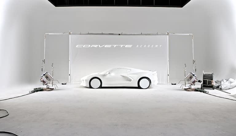 white Chevrolet Corvette in white room