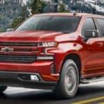 red 2021 Chevrolet Silverado truck on a road
