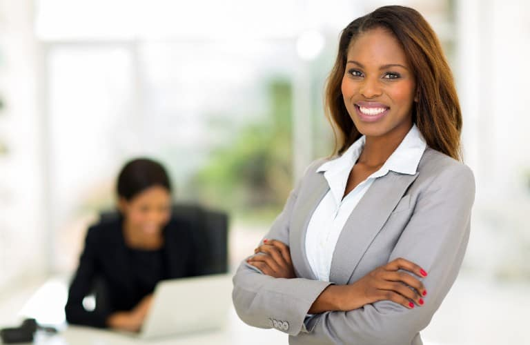 two women in an office setting