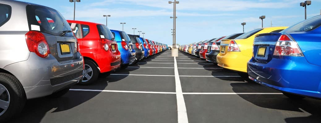 a dealership lot with many cars