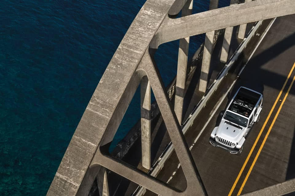2019 Jeep Wrangler driving on bridge