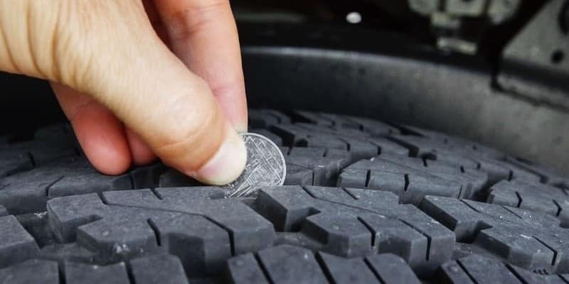 Checking the tread on a tire