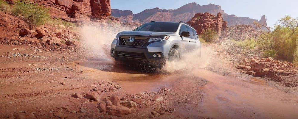 2019 honda passport in silver driving in rocky red desert