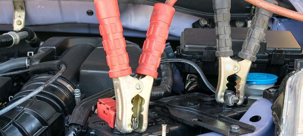 Jumper cables attached to car battery