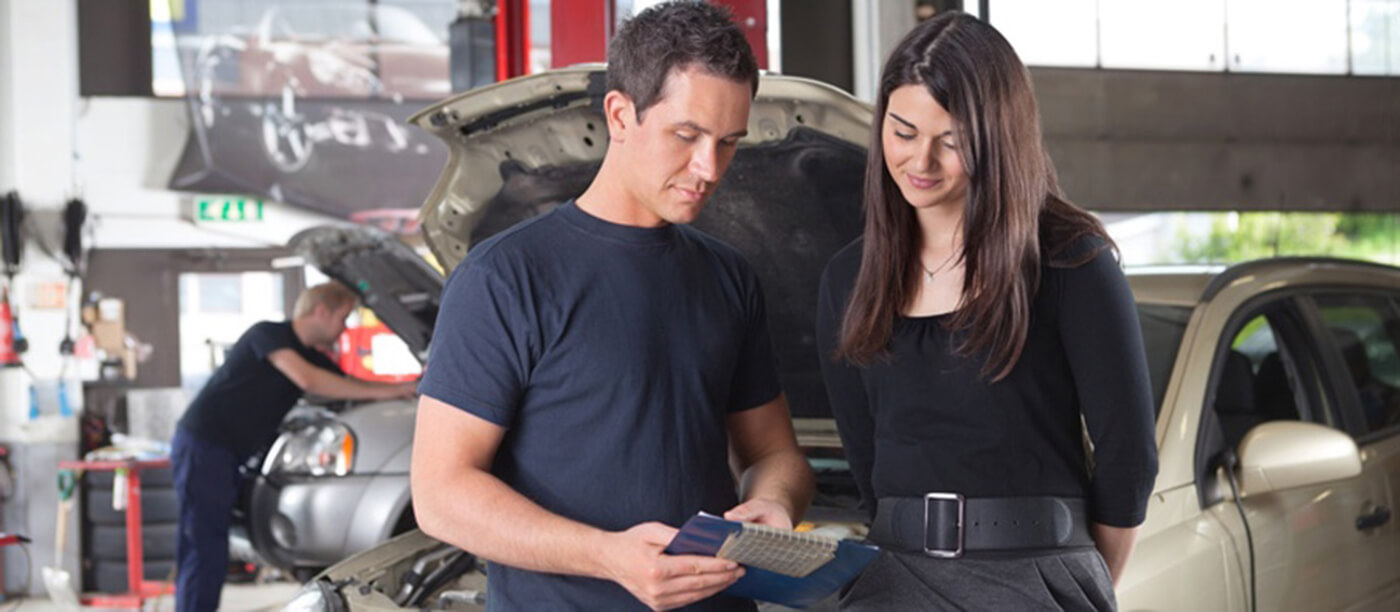 mechanic with customer
