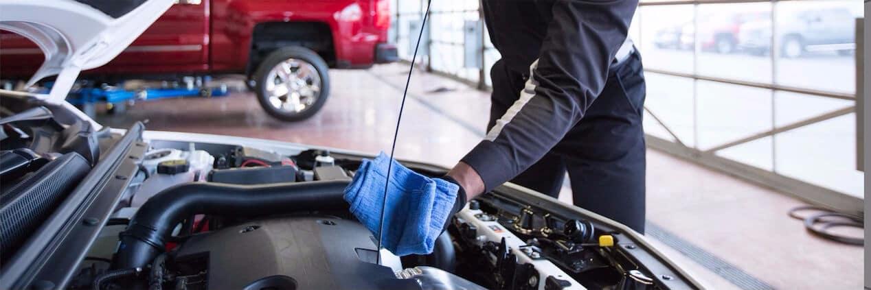 service tech performs oil change