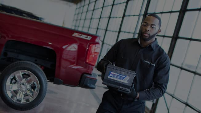 Chevrolet Service Tech with Battery