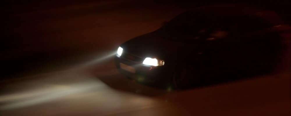 Arial View of Car driving with headlights