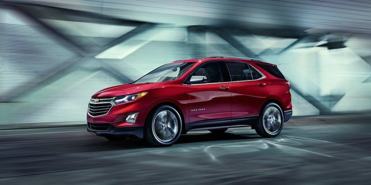 2019 Chevrolet Equinox in red driving down road