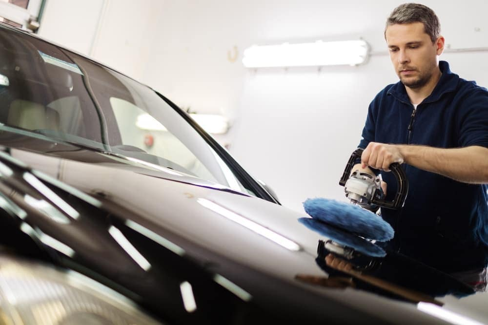 Man polishes car with buffer