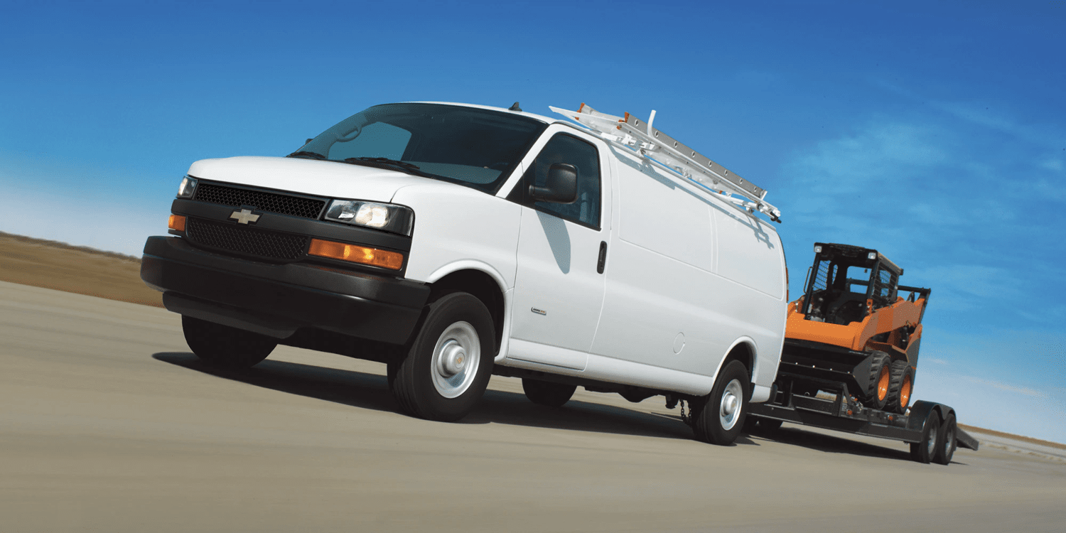 2019 Chevrolet Express Cargo Van towing digger