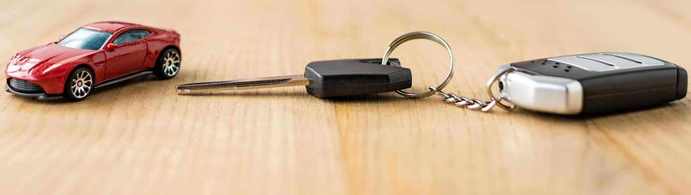 Key Fob and Key on Table