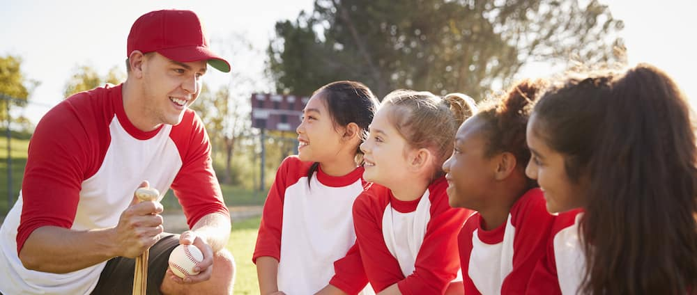 Youth Baseball Players with Coach