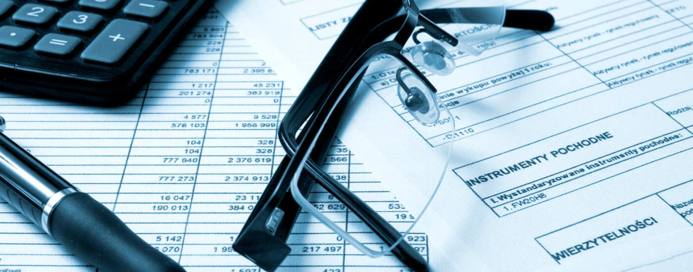 Finance paperwork with glasses and calculator