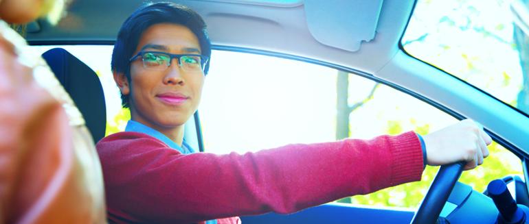 Man Test Driving a Car