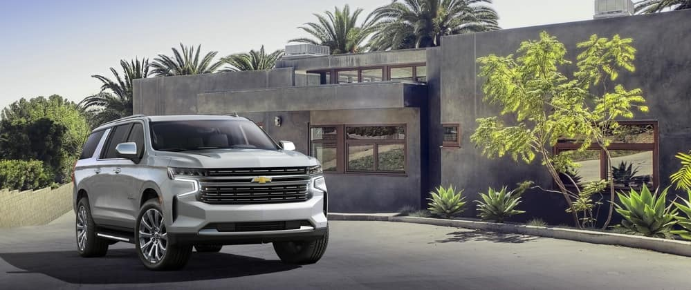2021 Chevy Suburban parked in front of a house