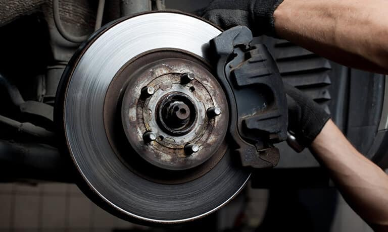 Mechanic changing brake pads