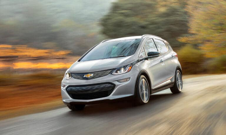 2021 Chevy Bolt EV exterior driving along autumn countryside road