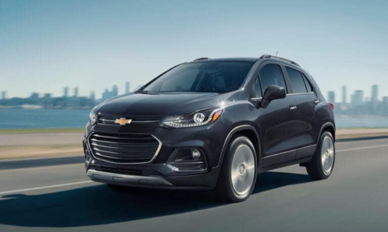 2021 Chevy Trax exterior highway with city skyline in background