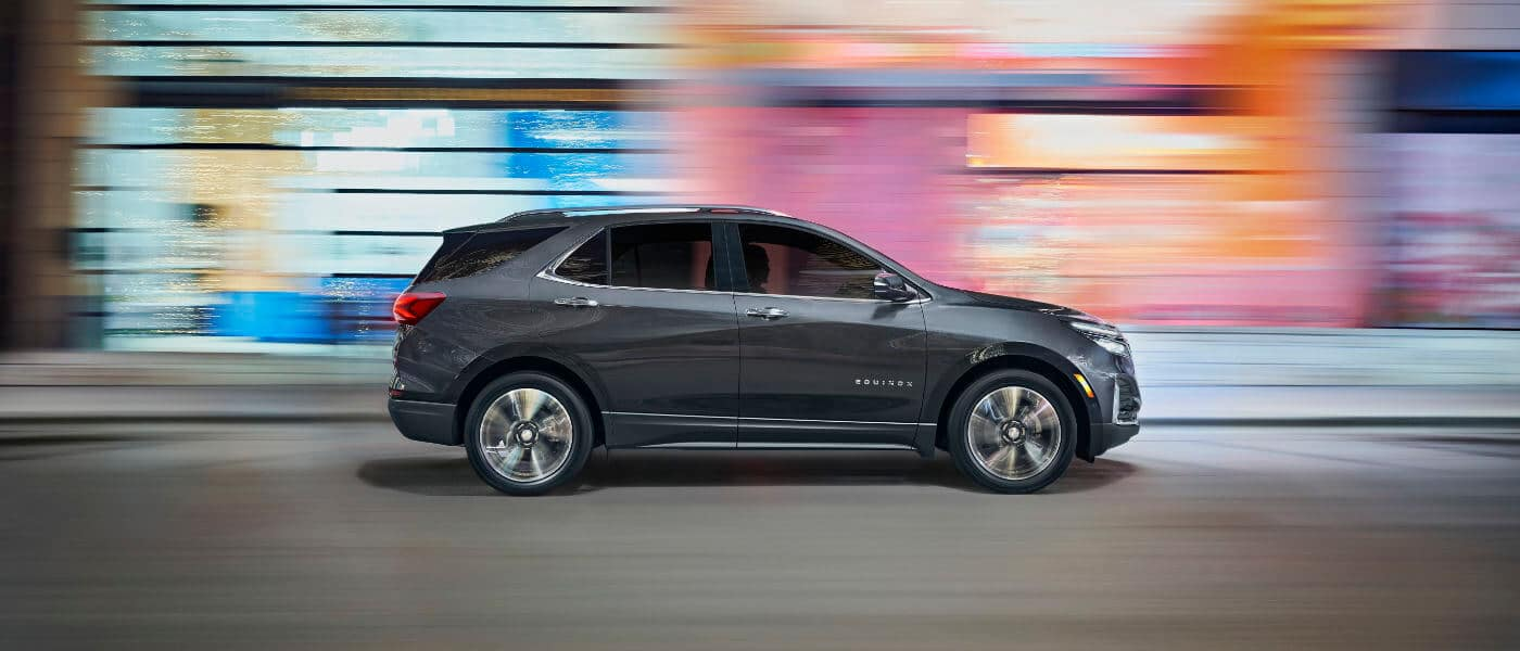 2022 Chevy Equinox  side exterior view driving through the city