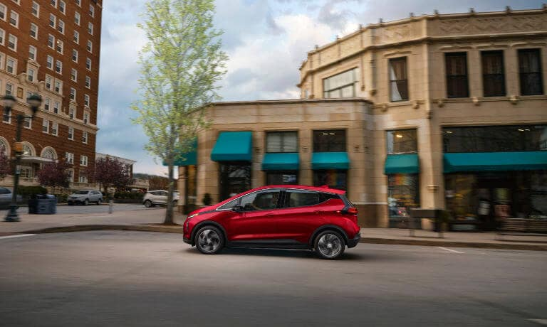 Red 2022 Chevy Bolt side exterior driving