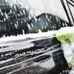hands hold sponge for washing car