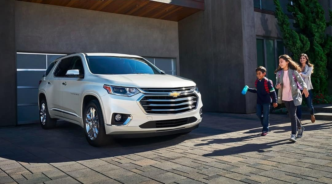 2019 Chevrolet Traverse parked in front of house