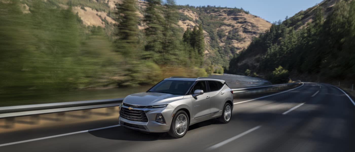 2020 Chevy Blazer driving on a highway in the mountains