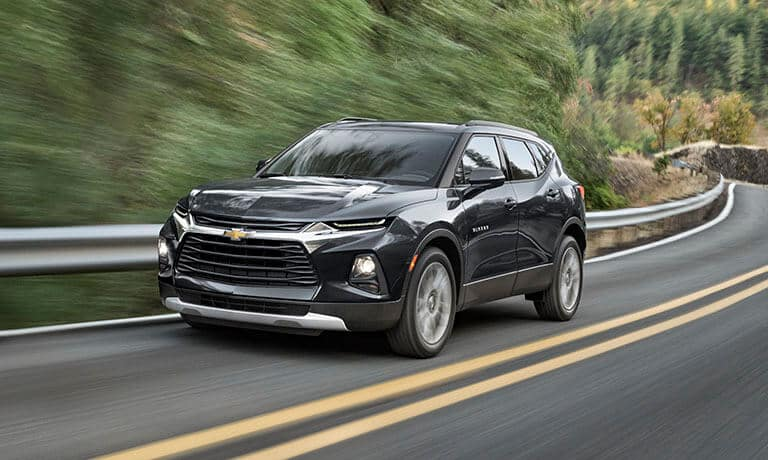 2021 Chevy Blazer exterior driving on a forest road