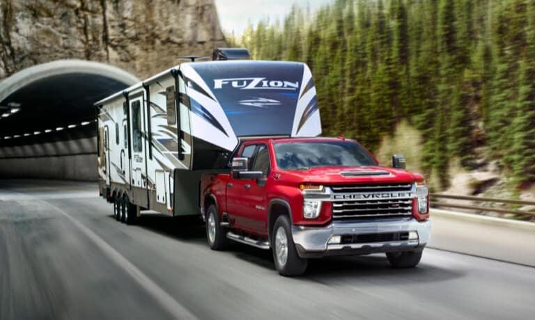 2021 Chevy Silverado 2500 exterior towing camper on highway