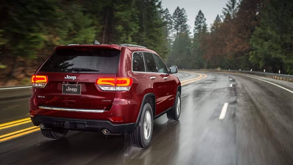 2019 Jeep Grand Cherokee in a rainy forest