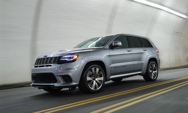 Silver 2020 Jeep Cherokee driving in a tunnel