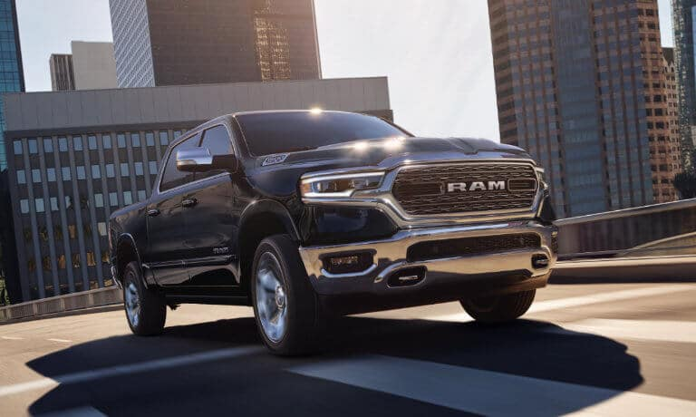 2021 Ram 1500 driving through the city exterior view